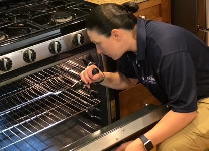 Female home inspector in windham nh performing comprehensive home inspection.