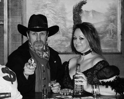 Saloon girl and her cowboy. whickey and guns and flirty women