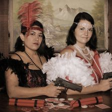 dressed up in roaring twenties flapper girls. Don't mess with them, they are packing heat!
