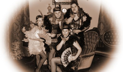 Dressiing up is fun when a family of girls dress up like 1920's flapper girls blowing sweet kisses