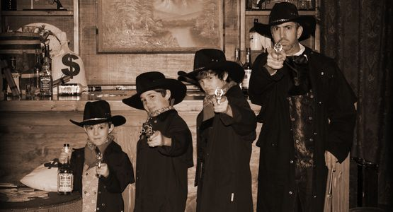Dad and his gunslining outlaws. Ra=ealistic replica guns make boys of every age smile or not