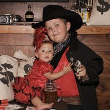 Young gunslinger protection his little saloon girl sister. All in good old ti me fun.