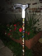 "Walking cane with LED lights and multi-color silk roses. Available in 29"" through 36"" length."