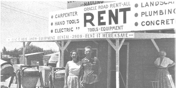 A black and white photograph showing the original owners of Oracle Road Rent-All and Sales,