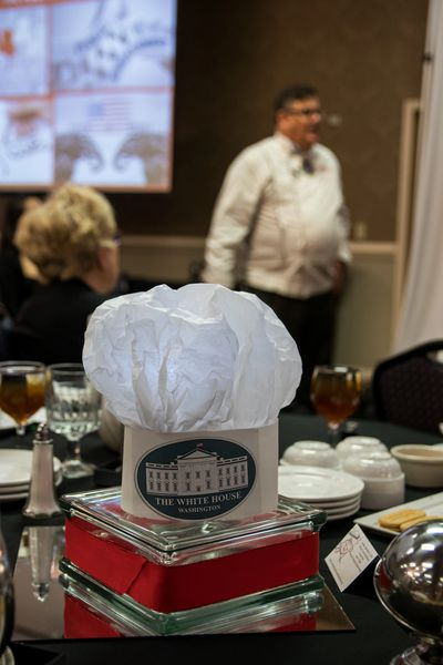 A homemade chefs hat for centerpieces at a Chicago, Illinois dinner and keynote speech for 200.