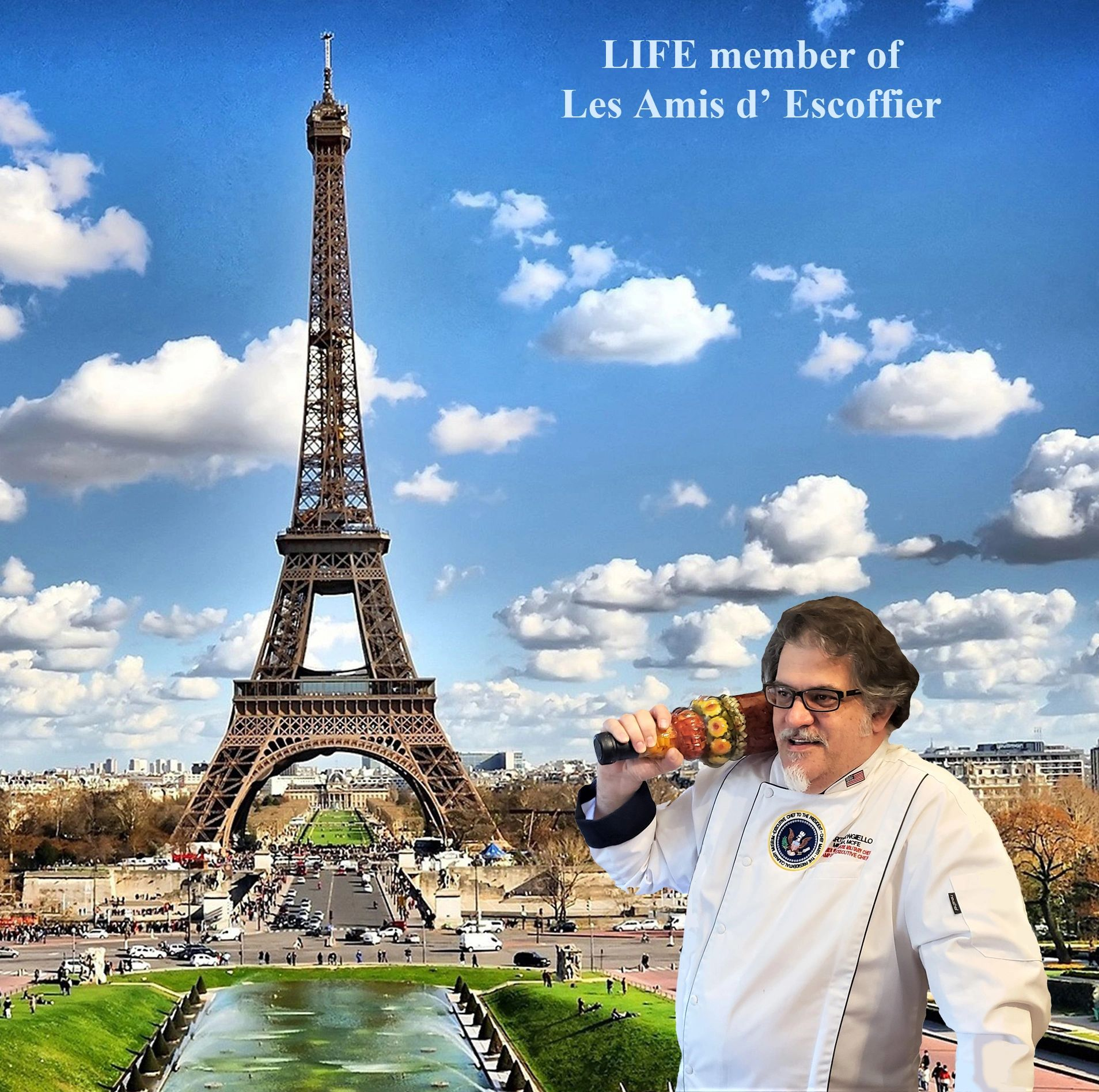 A photograph of Chef Marti Mongiello at the Eiffel Tower in Paris, France.