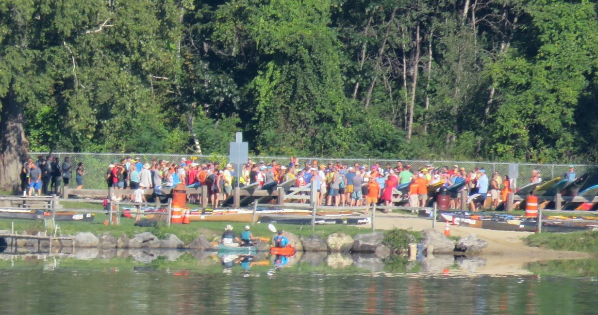 Paddlers await arrival of their teams' bikers for 2nd leg of the Josh, 2 1/2 loops around the pond