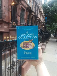 THE UPTOWN COLLECTION in front of Harlem townhouses