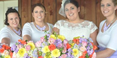 Pastel bridal bouquets of stock, roses, gerbera daisies, spray roses