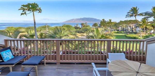 The main lanai at Maui Dream Place features a view of West Maui. Richard Schultz petal table visible