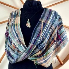 Hand woven shawlette using re-claimed cotton from unraveled sweaters and strips of demim.