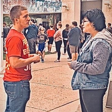 Man sharing faith in Jesus with student