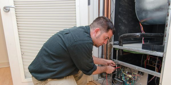 Heating and air conditioning technician in a service call for a repair