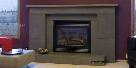 Concrete fireplace hearth, mantle, and surround.