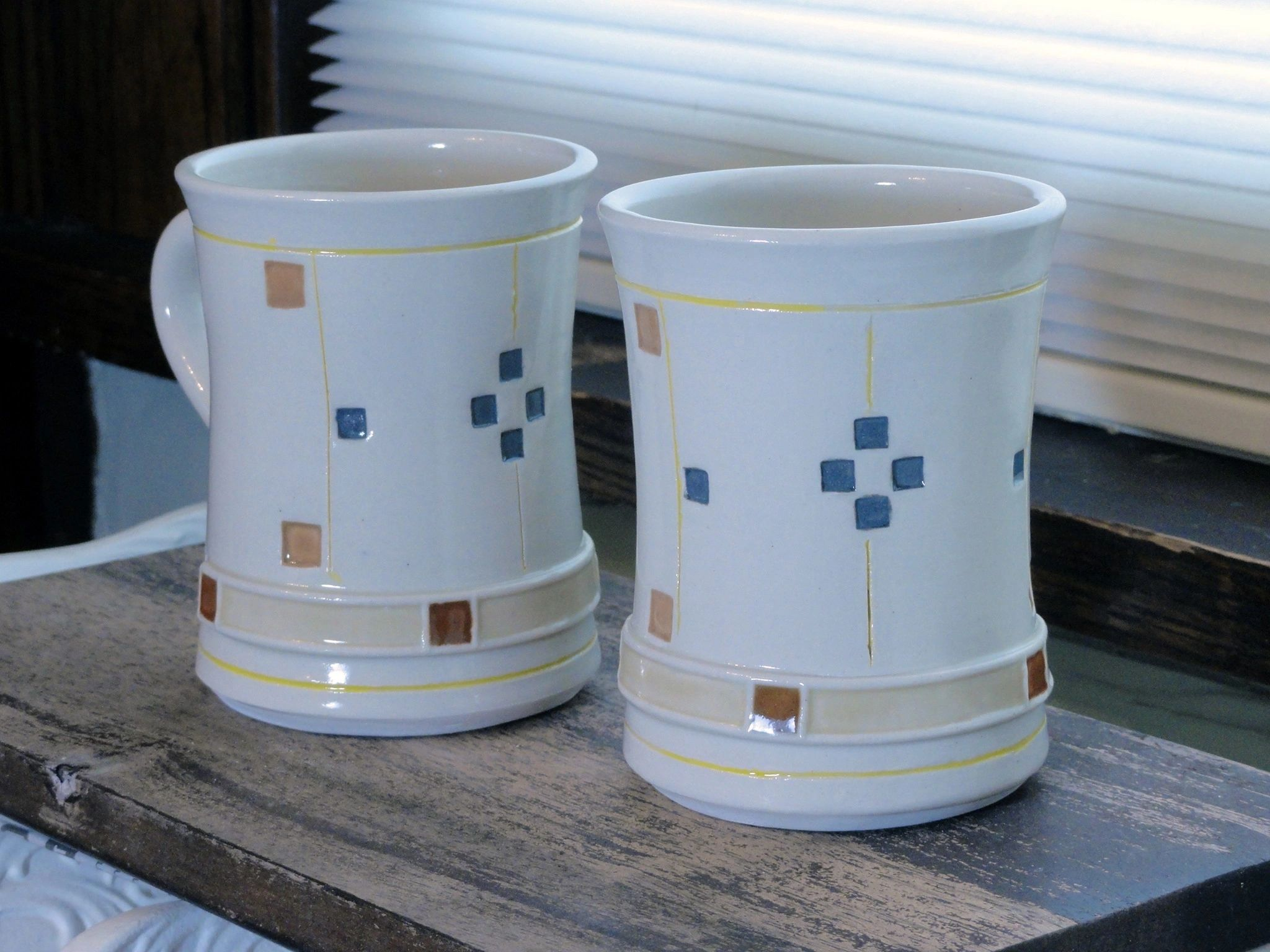 Two Prairie Olive mugs in porcelain. 8 ounces each. Dishwasher and microwave safe.