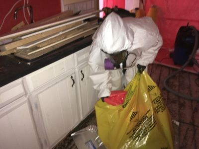 Disposing of the asbestos waste from asbestos containing flooring