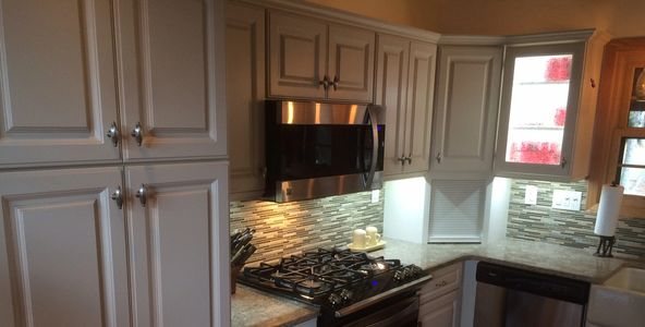 Project by Herman's Kitchen & Bath Design. Omege Cabinets, Cambria Quartz, Maple Wood, White Finish.
