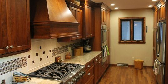 Project by Herman's Kitchen & Bath Design. Omega Cabinets, Cambria Quartz, Cherry wood, Nutmeg.