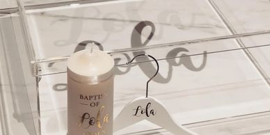 Clear acrylic christening box with gold acrylic details. Personalised hanger and church candle.