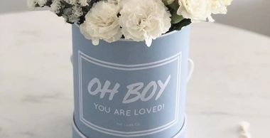 Customised baby blue flower box and baby milestone cards.