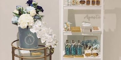 Pastel blue, white and gold mini gifts for welcome home baby boy.