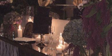 Candle vases and moody flowers.