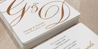 Luxury letter pressed wedding invitations. White and gold foiled design.