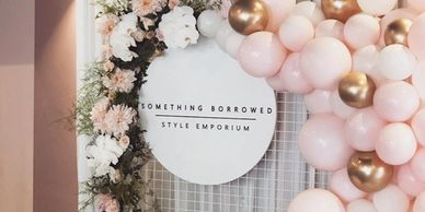 Pink balloons, florals, white mesh hire and full lunch launch event styling.