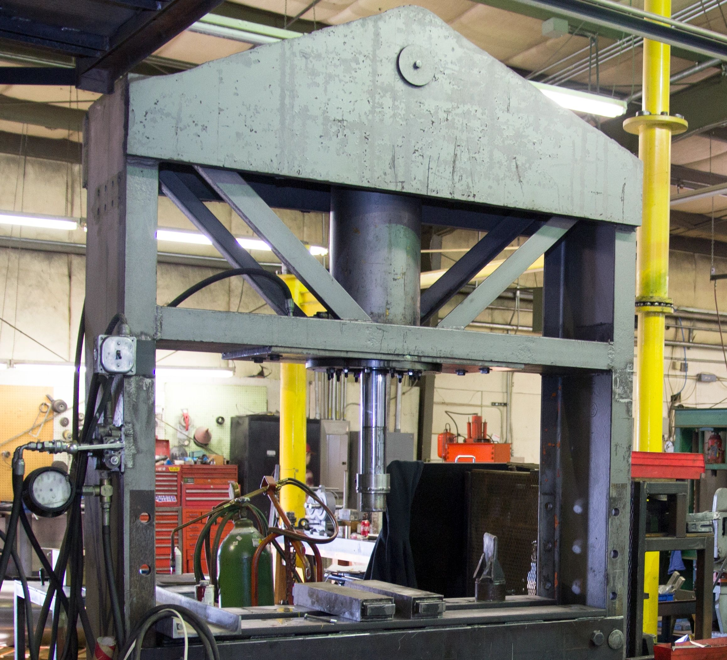 "{""blocks"":[{""key"":""1ok5h"",""text"":""Our 150 ton hydraulic press.  Able to broach keyways up to 1\""."",""type"":""unstyled"",""depth"":0,""inlineStyleRanges"":[{""offset"":0,""length"":62,""style"":""BOLD""}],""entityRanges"":[],""data"":{}}],""entityMap"":{}}"