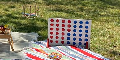 Add some fun to your picnic with games such as connect four, Ring Toss, Jenga, or Uno.