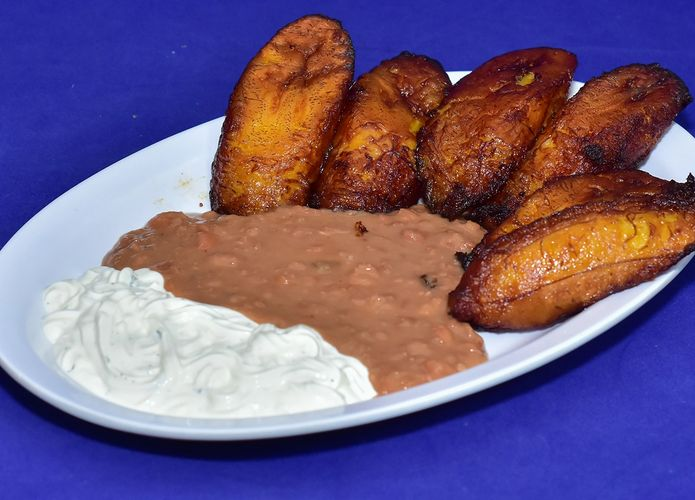 SWEET FRIED PLANTAINS WITH SOUR CREAM AND REFRIED PINTO BEANS
