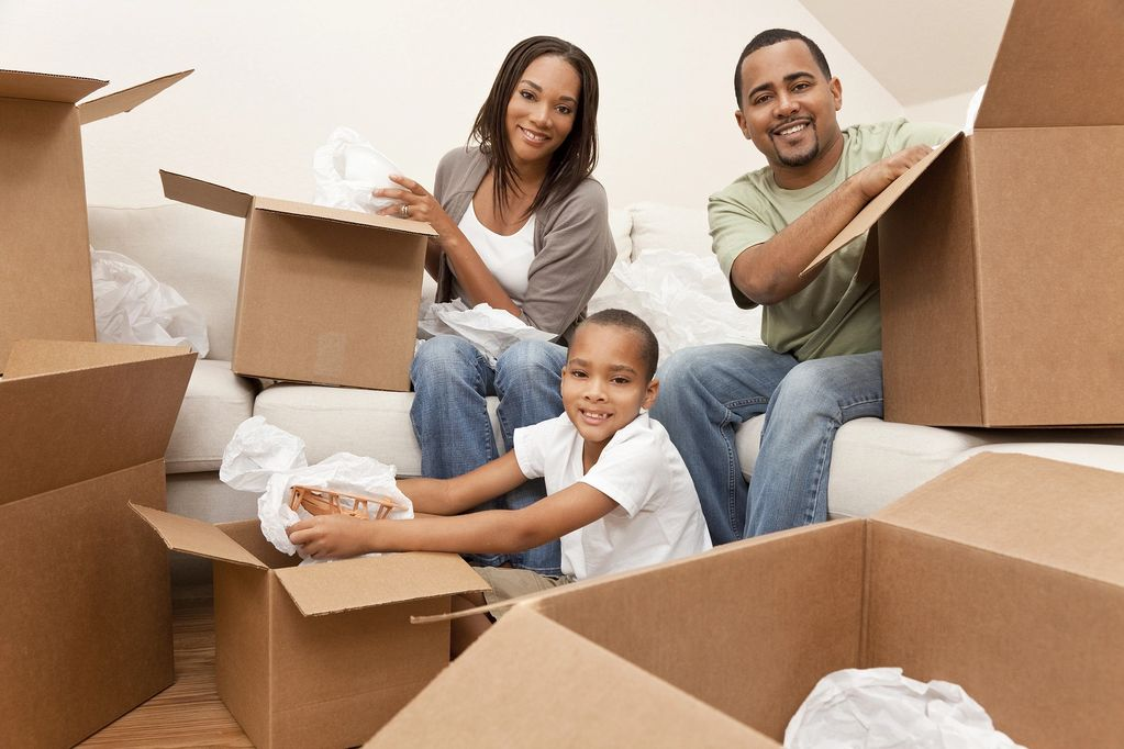 A local family prepares for their move by packing boxes