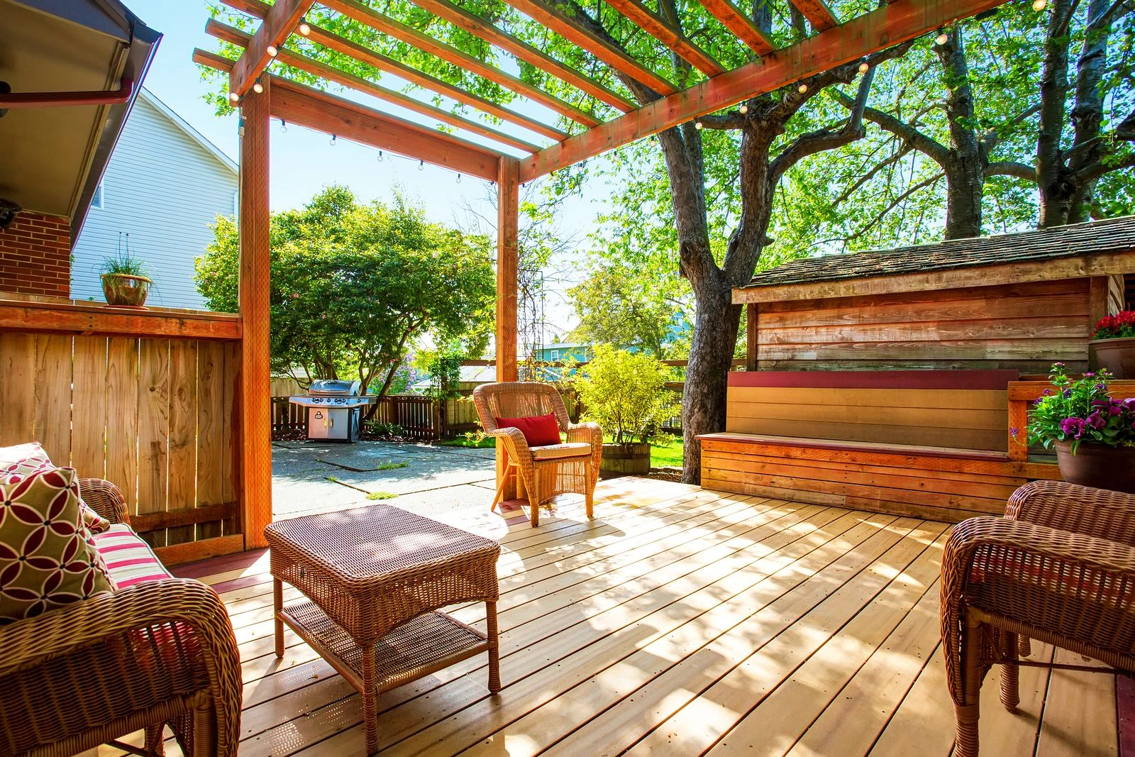 A cedar stained deck with a pergola for outdoor leisure
