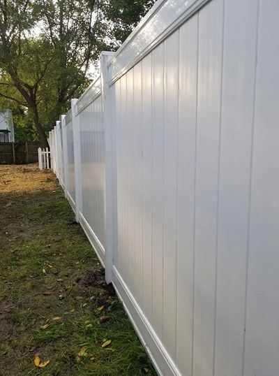 A white vinyl fence perfect for style and privacy