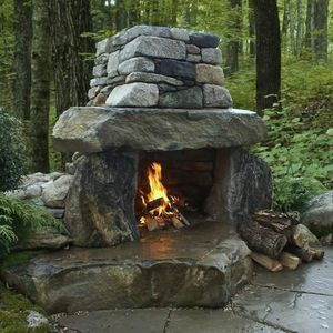 Outdoor fireplace made from natural boulders.