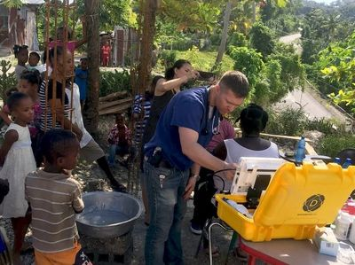 Doctor performing remote patient monitoring in Haiti while connected to a specialist in the US.
