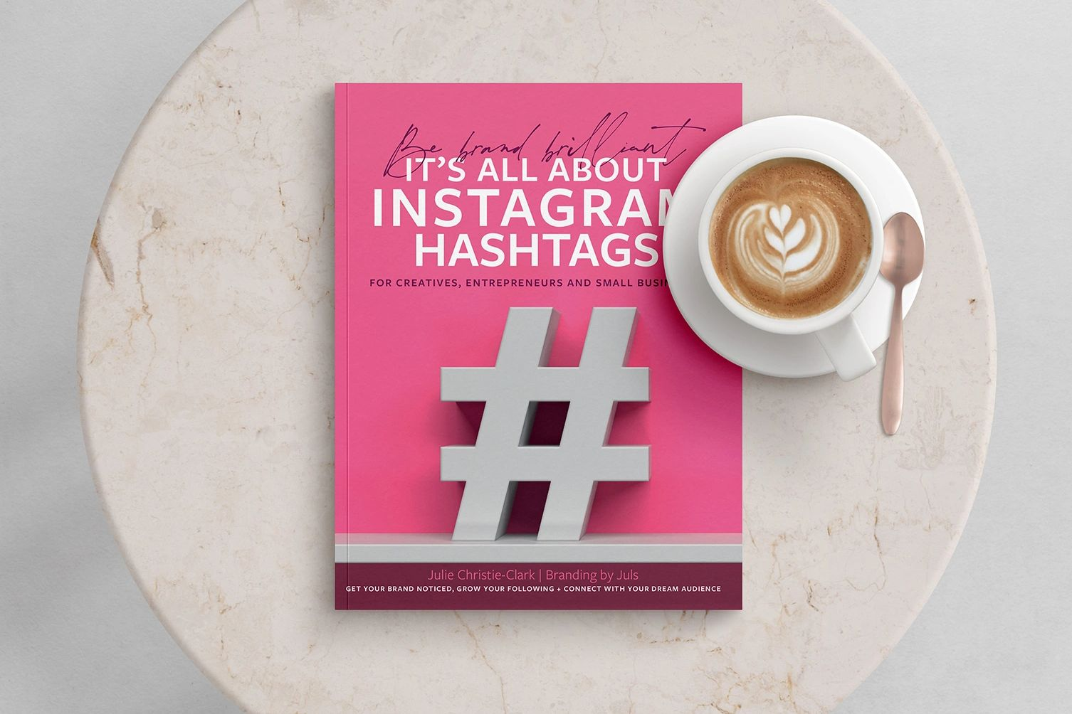 Be brand brilliant It's all about Instagram Hashtags book sitting on a coffee table with coffee cup