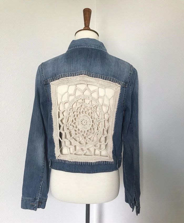 Hand cut, sewn and crocheted upcycled denim jacket.