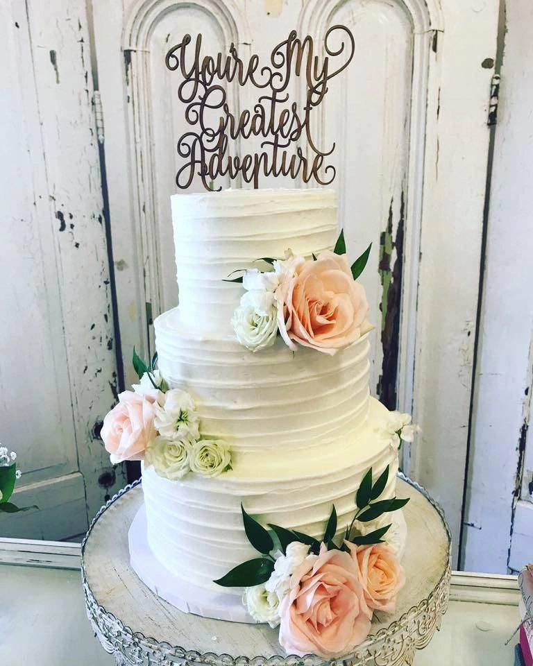 wedding cake rustic buttercream and flowers