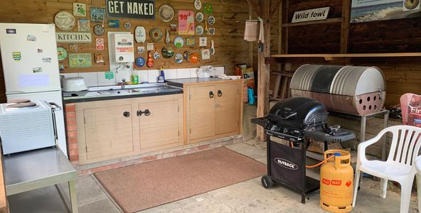 Outdoor cooking, naturist cooking, naked cooking