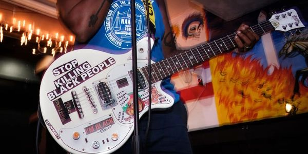 Photo of QADR's guitar from The Muslims punk band. Photo by Arvin Temkar from Buzfeed News.
