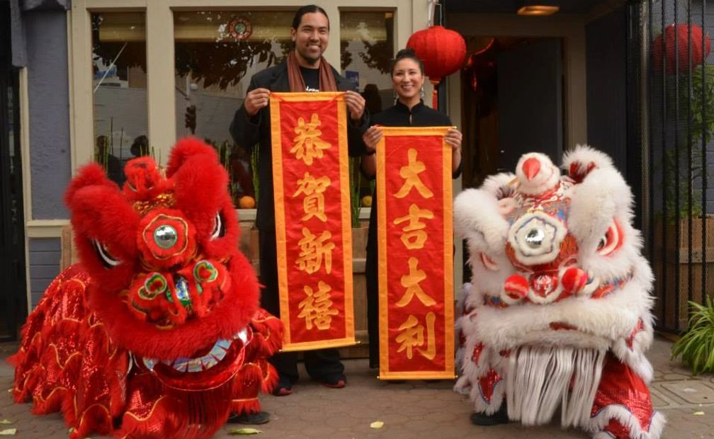 GRAND OPENING PHOTO OF FOUNDERS DAVID AND NAJIA WEI, WITH LION DANCERS, IN OAKLAND, CALIFORNIA