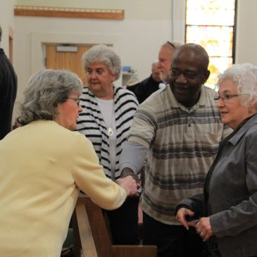 Members of the church greet each other in Christian fellowship.