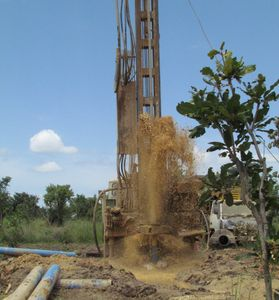 Water drilling boreholes to provide clean water for impoverished villagers.