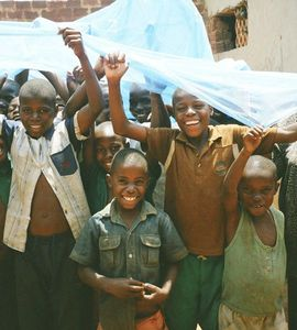 distributing mosquito nets at a boarding school in Uganda.