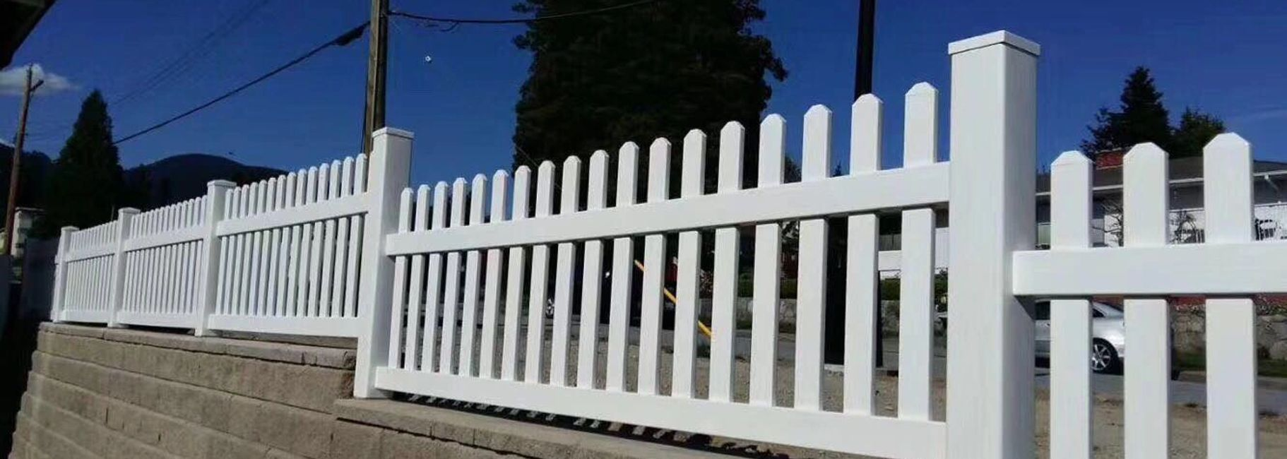 Vinyl Picket Fence on Retaining Wall