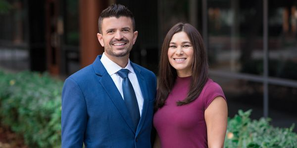 Danny Drysdale and Stefanie O'Sullivan  stand outside of Finance of America's Mission Valley Office.