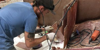 Outer transom skin has been removed, stringers are being glassed and will then be poured w/Seacast™.