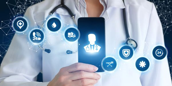 Digital health symbolized as happening through a smartphone held by a doctor.