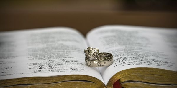 Wedding rings on the bible. Christian wedding. Alexandria MN Wedding Photographer